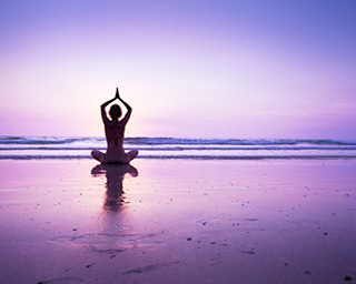 Yoga sunset purple ocean header